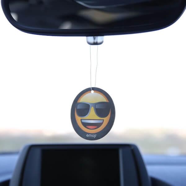 emoji air freshener on rearview mirror