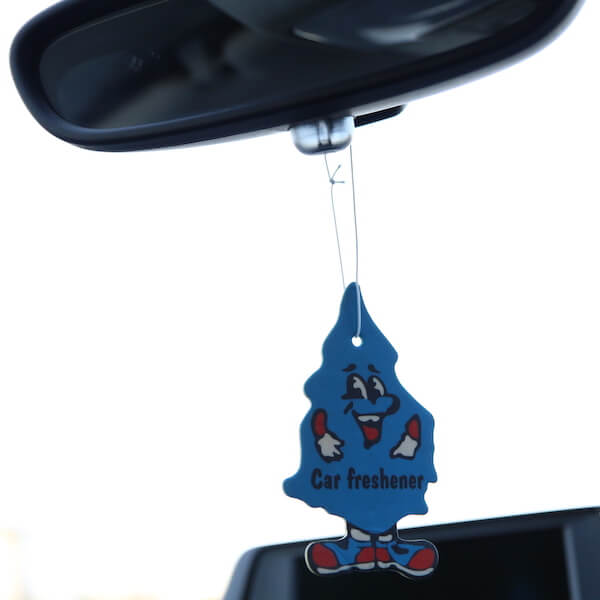 paper air freshener on rearview mirror